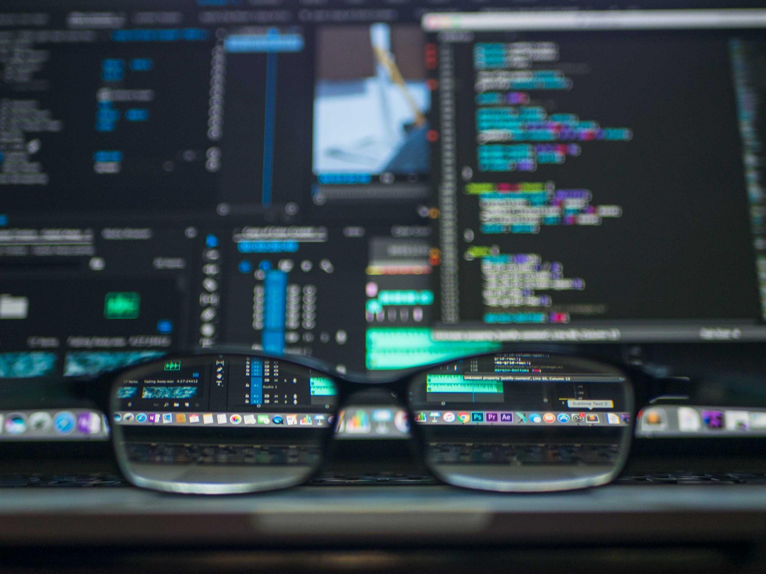 Computer monitors and glasses.